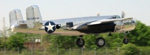A massive B-25 Mitchell bomber shines in the sun as it takes off from the Columbia-Owens Airport.