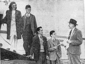 "At the County Airport, County Executive Herbert C. Gerlach gives Hugh E. Hutchinson (second from left) a certificate of his rank as ""General"" in Westchester County for selling the most war bonds during the Seventh War Loan drive."