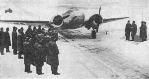 An Army plane about to break the tape on the snow-covered field.