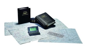 Shown are Jeppesen Airway Manual, charts and the TechStar Pro, an electronic flight computer and personal organizer.