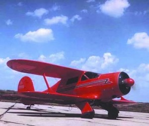 This Staggerwing G-17S, the last G model Staggerwing built at Beechcraft's Wichita factory, is seen at the Wichita Municipal Airport (now McConnell AFB), in the late 1940s, after it was sold to oilman Willis Hartman.
