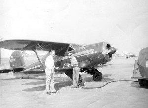Ivan Behel (left) waits as Mr. Hartman's Staggerwing G-17S (B-20/NC8031) is gassed up at the Wichita Municipal Airport (now McConnell AFB), circa late 1940s.