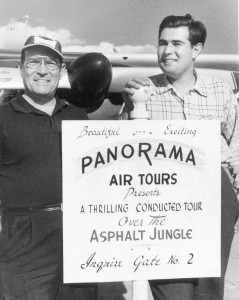 Ted Healy Sr. and Ted Healy Jr. with sign promoting their Air Tours over the Asphalt Jungle.