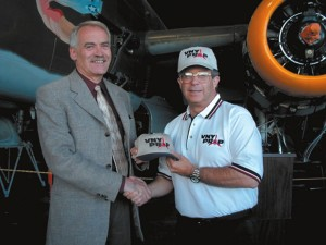 VNYPROP President Elliot Sanders (right) presents AOPA Regional Affairs VP Bill Dunn with one of the group's baseball caps.