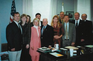 L to R, front row: Richard Dilbeck and wife Cheryl; Giacinta Bradley Koontz; Sen. Pete Knight; Tamara and Greg Michael; William Withycombe; and Larry Kephart. L to R, back row: Mrs. Prothero and Ed Prothero and Phil Randall (in gold shirt)