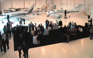 Guests enjoy music, food, drink and conversation at a reception for the opening of Sun Air's Executive Flight Center.