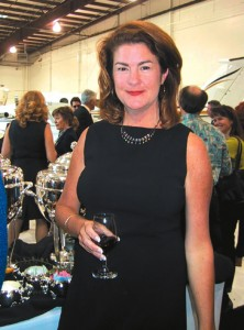 Janie Cook, director of sales and marketing of Air Gourmet, at Sun Air's recent reception. Air Gourmet catered the event marking the opening of Sun Air's Executive Flight Center.
