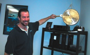 Facilities Manager Matt Fowle rings the sales gong at Mid-Continent Instruments' Van Nuys office. The West Coast branch of Wichita, Kansas-based Mid-Continent was established in 1991.