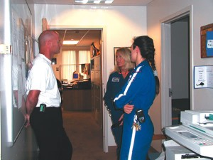 Dr. Mark Maertens, AirLife medical director, confers with nurses Gray and Parris.