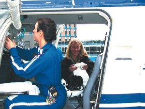 Flight nurses Missy Parris and Linda Gray check the medical supplies aboard the Air Methods Bell 407 helicopter.