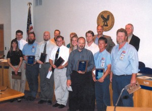 Balchen/Post awardees, which each received a plaque and a monetary performance award. Behind the team are ACPAA board members Peter Neukirch, Arapahoe County Commissioners.