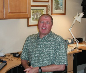 "Dave Clouse of Vacation Rentals by Owner at the ""international headquarters"" of his virtual business."