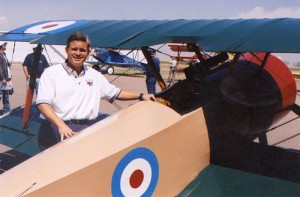 "Andy Parks, president of the Lafayette Escadrille Foundation, with the foundation's 3/4 scale Sopwith ""Pup."""