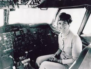 Emily Howell Warner in a Frontier Boeing 737 (1973).
