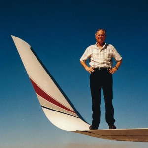 Joe Clark, standing on a GII wing with blended winglets, is chairman of Aviation Partners Boeing Company. He looks forward to putting the technology on the entire Boeing fleet.