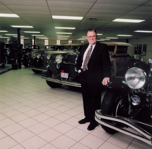 Dee Howard, in front of a few of the cars in his classic car collection.