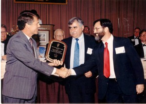 Joseph Lahoud, president of LC Technologies (middle), with Dixon Cleveland of LCT (to his right), accepts an award for Eyegaze technology.
