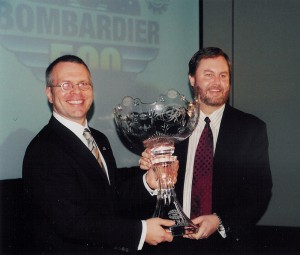 Eddie Gossage (right), Texas Motor Speedway general manager, joins with Andrew Farrant, general manager, Bombardier Aerospace, Business Aircraft, to introduce Bombardier as the title sponsor of the speedway's June IndyCar Series.