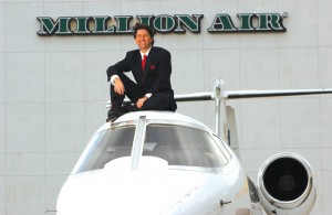 CEO Roger Woolsey, on top of a Lear 55 in front of Million Air Houston.