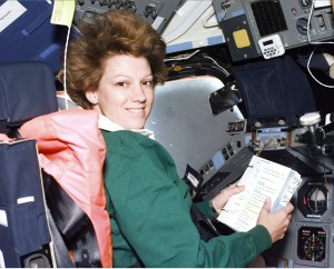 Commander Eileen Collins consults a checklist while seated at the flight deck Commander's station in the Shuttle Columbia during STS-93.