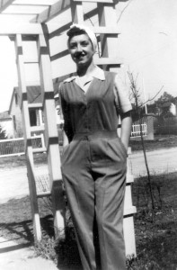 "Josephine Rachiele in front of the family home in West Babylon, Long Island, in typical apparel for ""Rosie the Riveter"" (circa 1945)."