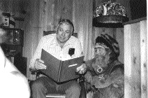 "The late character actor Slim Pickens was the narrator in Bobby Bridger's first recording. Here, Pickens studies the ""Seekers of the Fleece"" script while Timberjack Joe looks on."