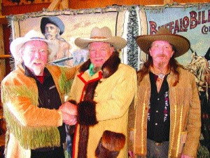 Bobby Bridger, center, stopped to visit with local Buffalo Bill impersonators Stanley Beug (left) and Al Huffman (right) at the Buffalo Bill Museum.