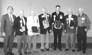 The Colorado Aviation Historical Society presented Chuck Holmes with a Special Recognition Award in 2001. Holmes, second from left, is shown with (L to R) Gordon Page (at the time president of the CAHS), Robert C. Cherry (2001 inductee, now deceased), Lt.