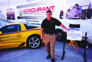Ron Hill of the Bob Bondurant School of High Performance Driving, at the Bondurant display at the Scottsdale Business Aircraft & Jet Preview.