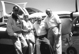 L-R: Lee Auger, Ev Blechman, Jimmy Weldon and Fred Blechman, at Bakersfield's Meadows Field Airport, in front of Weldon's Beech Bonanza.