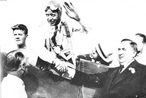 A victory wave from Doug Davis and congratulations from Vincent Bendix at the end of the1934 Bendix Trophy race from the West Coast to Cleveland.