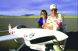 John and Patricia Sharp, of Lancaster, Calif., with Nemesis.