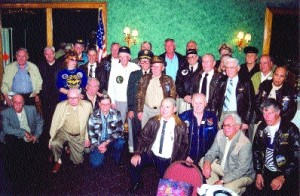 Twenty-eight members pose at a recent monthly dinner meeting of the Two-Block Fox Squadron of the Association of Naval Aviation at the Odyssey Restaurant.