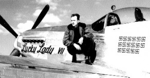 "Captain Ernie Bankey, ""The Tiger of Bonn,"" and his P-51 Mustang, ""Lucky Lady VII."" The 17 symbols under the canopy represent the 17 aircraft he destroyed on the air and on the ground."