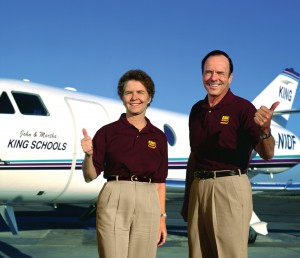 Martha and John King, principals of King Schools, Inc., in front of their Falcon 10.