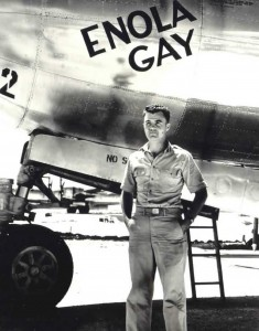 Col. Paul Tibbets in front of the Enola Gay.