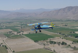 The Bull Stearman over the Flying M Ranch, returning from Reno/Tahoe International.