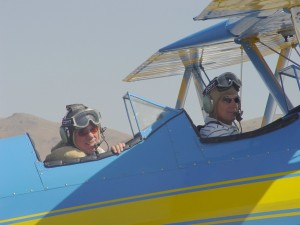 Mike Gillis and Peter Ueberroth return from a flight in the Bull Stearman.