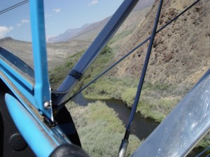 Barron Hilton's Bull Stearman is the perfect vehicle to offer an IMAX-type journey over the vast Flying M. Ranch.