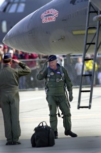 Retired Brig. Gen. Chuck Yeager salutes Maj. Gen. Doug Pearson, commander of the Air Force Flight Test Center at Edwards, after stepping from an F-15 Eagle on Oct. 26, 2002, at the Edwards Open House and Airshow.