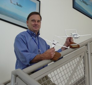 CEO Rick Adam, holding models of the A500 and A700 at headquarters near Centennial Airport.