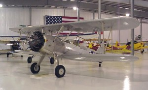 This silver 1941 Boeing Stearman, owned by Greg Herrick, is on display at the Golden Wings Museum.