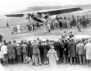 Spectators stand on their tiptoes to get a glimpse of this 1927 Ford 4-AT Tri-Motor, during the original Ford Air Tours.