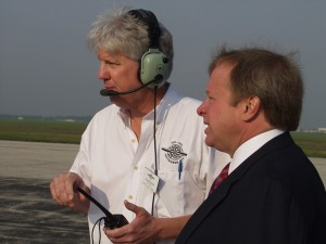 Greg Herrick and Edsel Ford II are never too busy to talk about airplanes; Ford waved the flag to start the National Air Tour 2003—something his grandfather did more than 72 years ago.