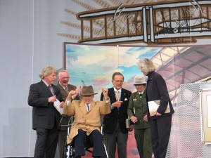 Harry Combs officially donated the Combs-Wright Flyer to the National Park Service. L to R: Mark Kennedy, Neil Armstrong, Harry Combs, Senator Ted Stevens, National Park Service Director Fran Mainella and Secretary of the Interior Gale Norton.