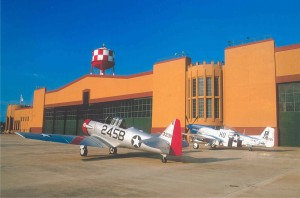 A sharp T-6 Texan and shiny P-51 Mustang await their next flight on the Fantasy of Flight ramp.