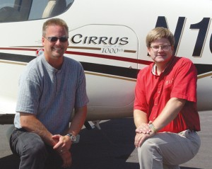 L to R: Dale and Alan Klapmeier in front of their 1000th plane sold.