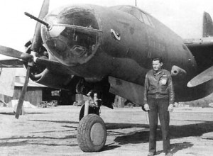Bob Hoover in front of the Martin B-26 Marauder he rescued from the beach at the Messina Straits in Sicily during World War II. Hoover was awarded the Distinguished Flying Cross for that remarkable feat.
