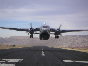 Hawkins & Powers Aviation's C-119C Flying Boxcar takes off for the trip to Africa.