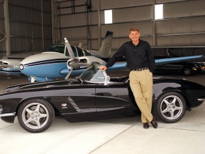 Charlie Johnson, in front of his 1962 Corvette LT4 Grand Sport, occupies a hangar at Centennial Airport with Paul Besterveld.